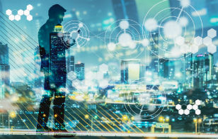 Double exposure of night city light and silhouette of business man standing and using smart phone with futuristic connection icons