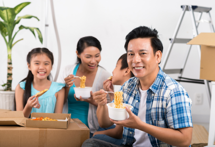 Happy Vietnamese family having first meal